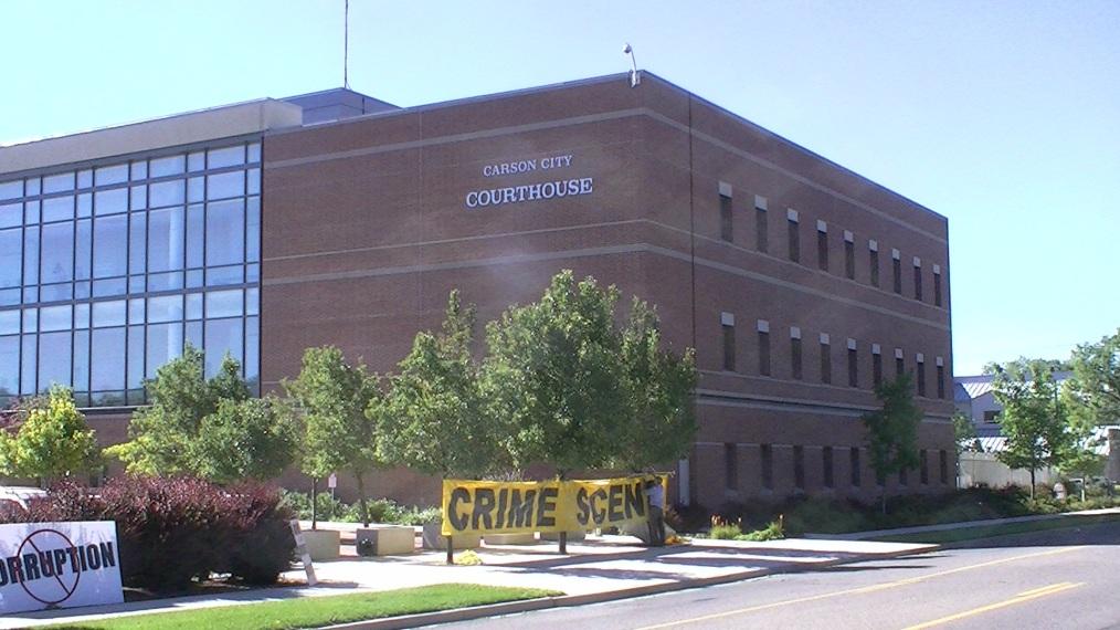 Nevada Attorney General Catherine Cortez Masto and Carson City courthouse judge James E. Wilson protest